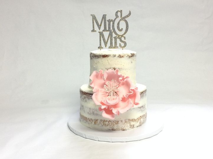 2 tier nashville wedding cake with Mr & Mrs cake topper and pink gumpase peony