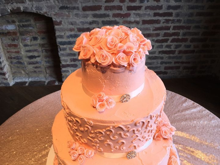 This butter cream blush color Nashvillie wedding cake by Connie Cakes is 3 tier covered  with...
