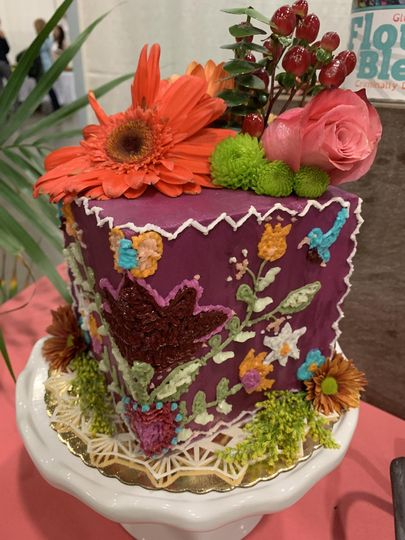 Cube cake with intricate custom design