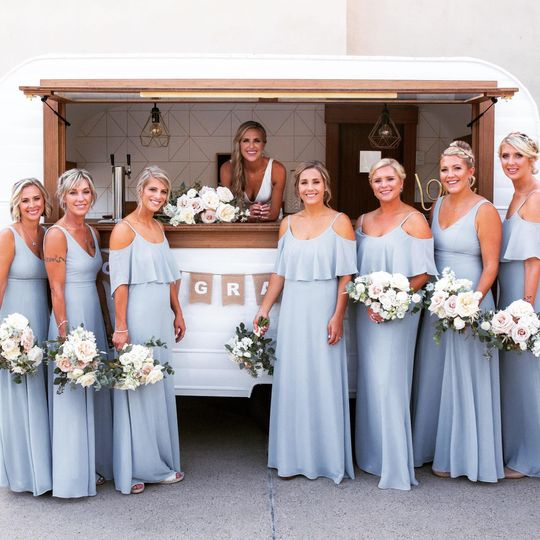 Bride and bridesmaids by the bar