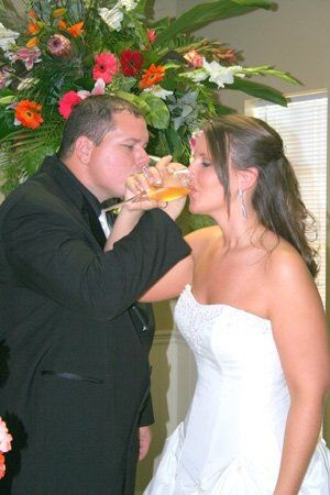 Here are the happy couple toasting their new life together....