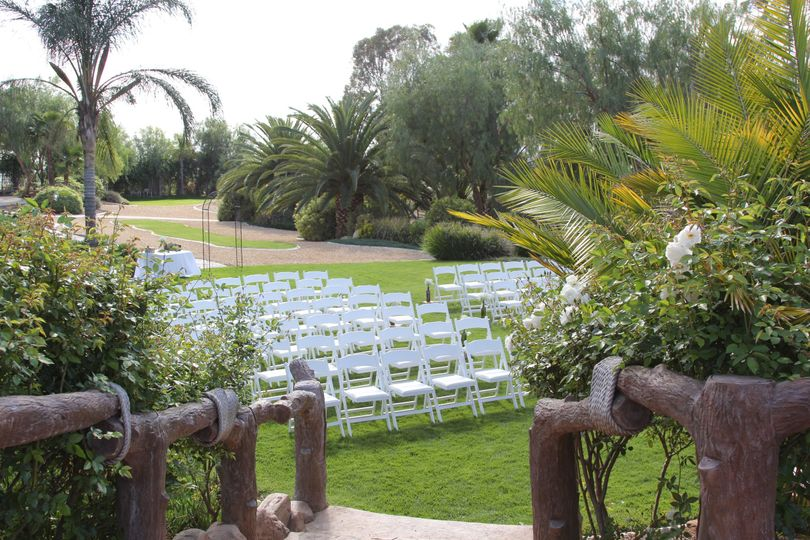 Outdoor ceremony seating area with view from reception area.