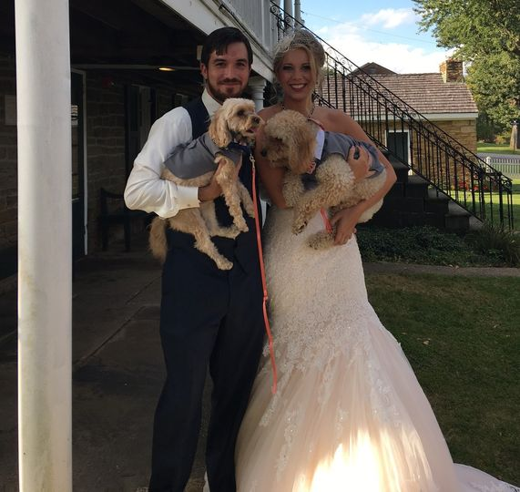 The newlyweds with their dogs