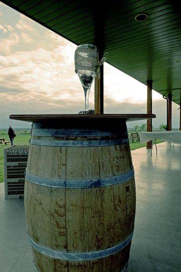 wine glass on top of wine barrel