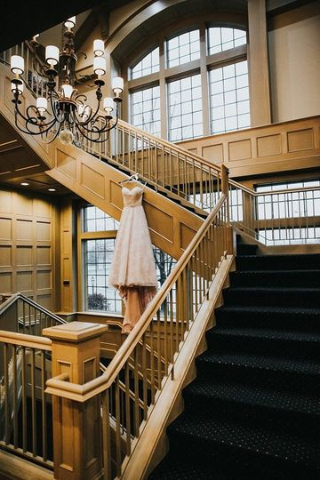Dress hanging on the staircase | Ester Knowlen Photography