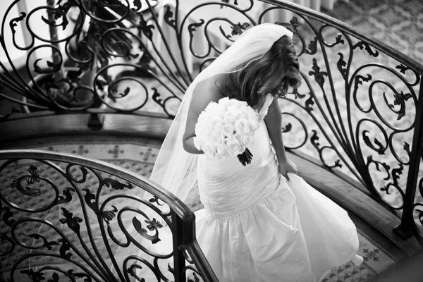 The bride walking up the staircase