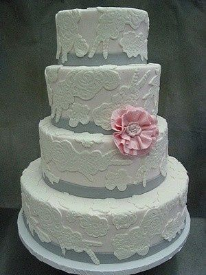 White Lace over pale pink with a pink peony creates wedding elegance.