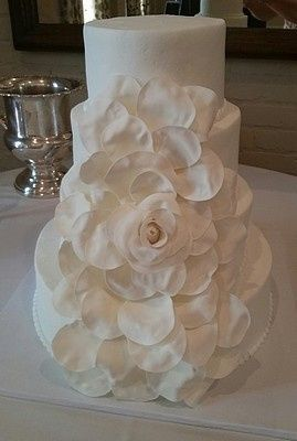 Buttercream frosting with sugarpaste expanding rose.