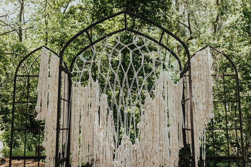Macrame backdrop for a boho chic wedding.  This was a custom design for an outdoor ceremony.