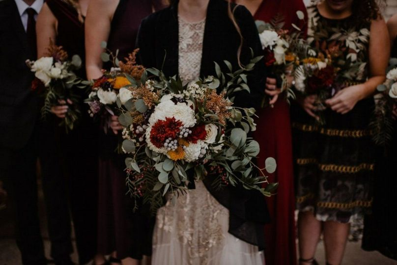 A cascading bouquet designed with eucalyptus for a gorgeous Fall wedding.