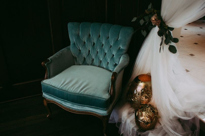 Vintage furniture rentals paired with a drapery installation and beautiful candles. Curating special...
