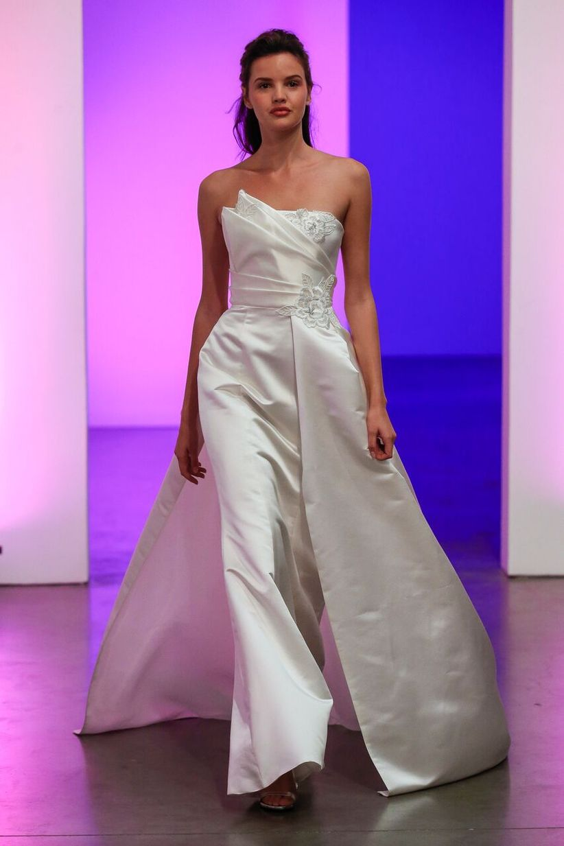 198772df64 We think opposites attract with these attention-grabbing asymmetrical  wedding dresses. Dan Lecca. Dress  Gracy Accad