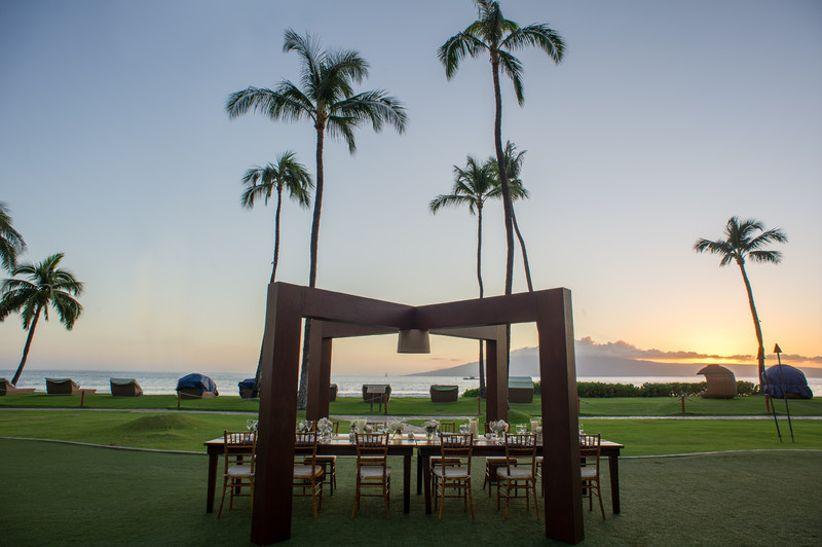 outdoor wedding reception at sunset overlooking the ocean