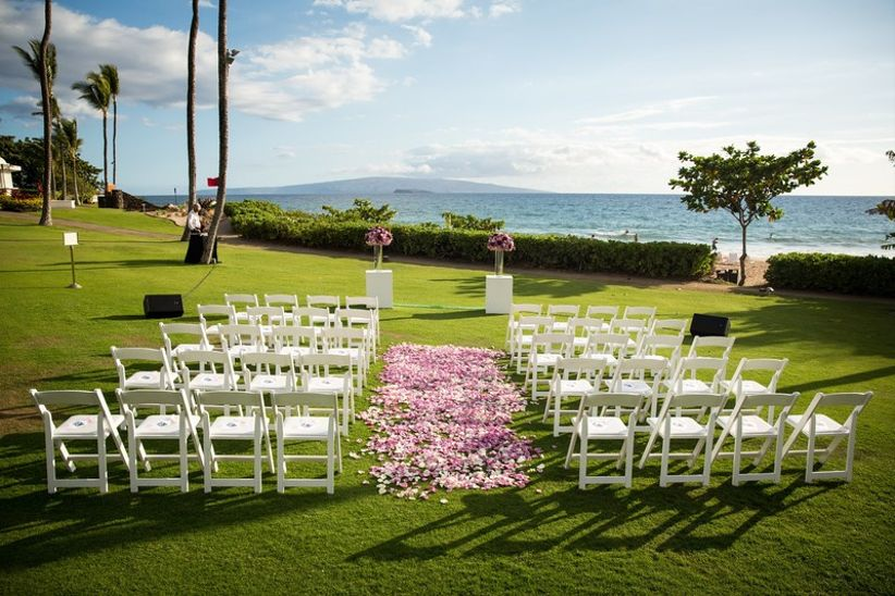 daytime outdoor wedding ceremony with oceanfront view