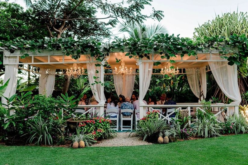 intimate reception dinner under ivy-covered gazebo at oahu wedding venue