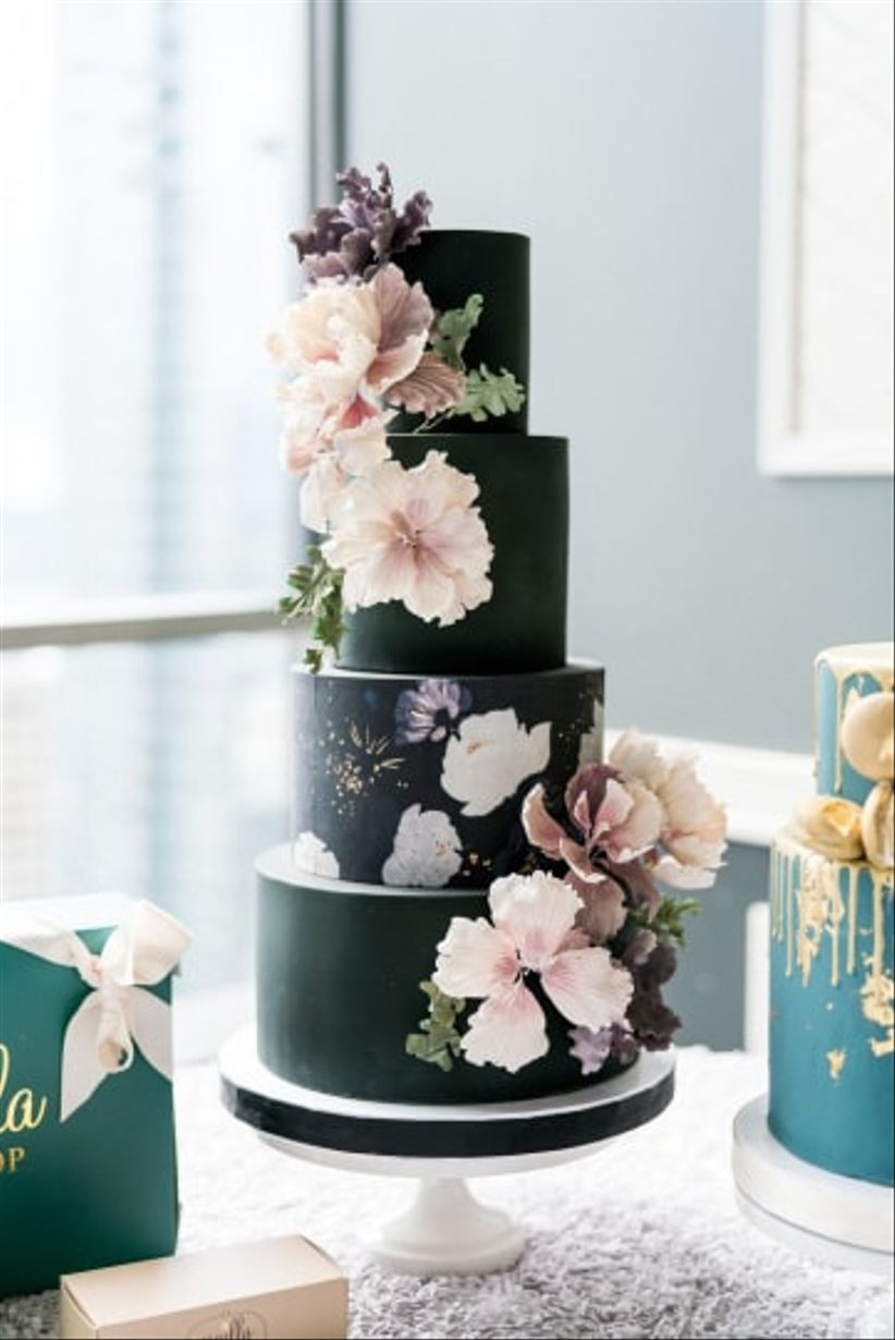 black fondant wedding cake with flowers