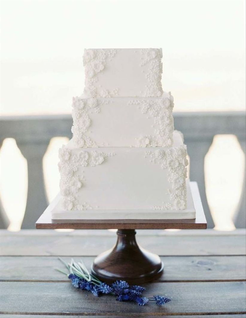 white bas relief wedding cake