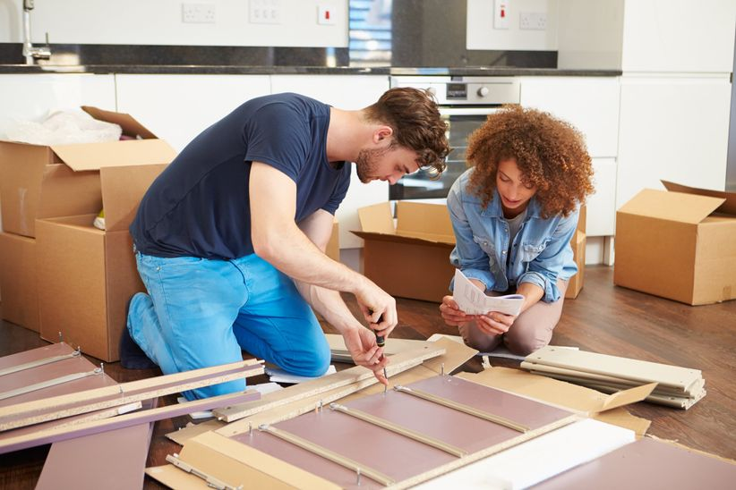 couple building furniture