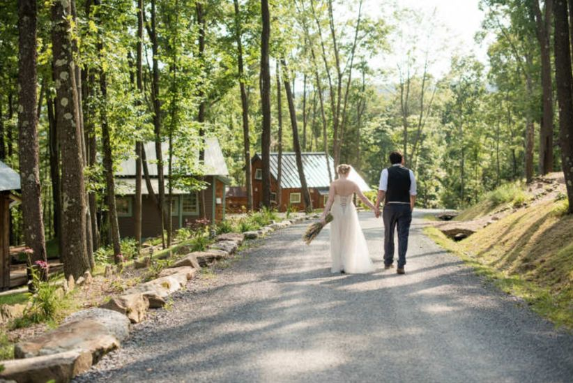 couple walking together in rustic woods