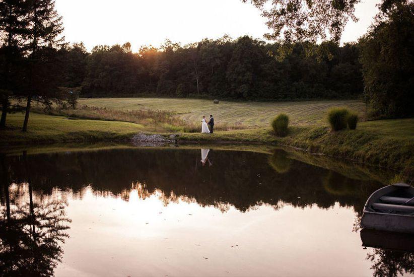 couple posing on pond