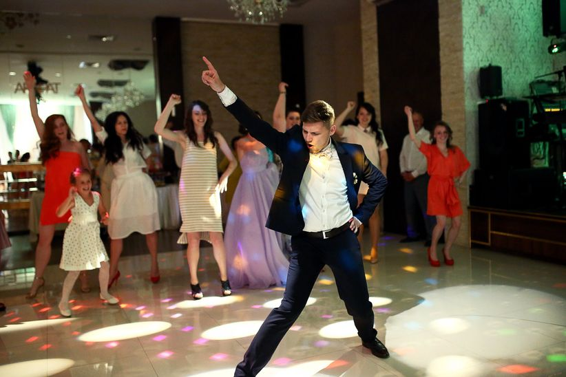 man doing silly dance at wedding
