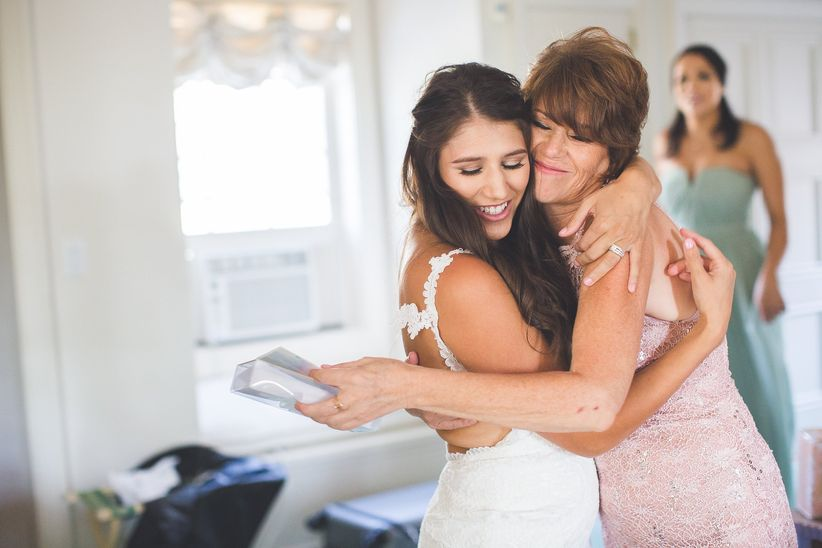 mother and daughter hugging on wedding day