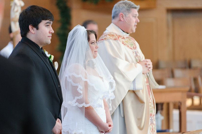 Catholic wedding vows 101 weddingwire heres what you need to know about catholic wedding vows as you plan your ceremony junglespirit Image collections