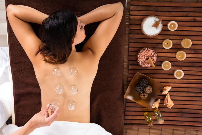 woman doing cupping therapy