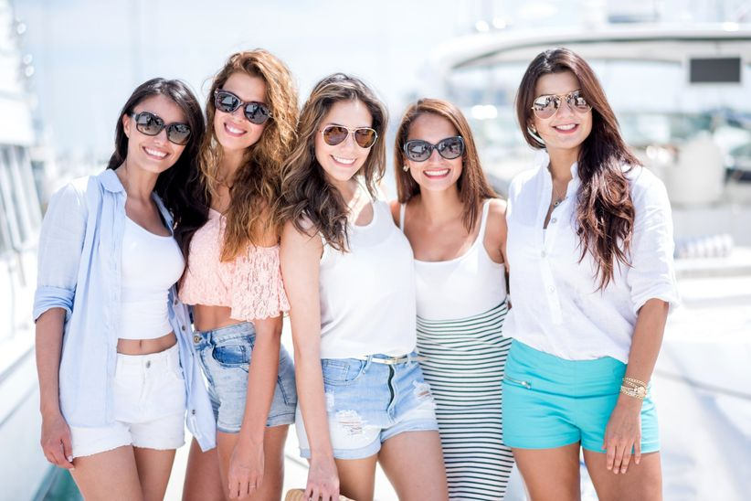 women posing in front of yachts in miami