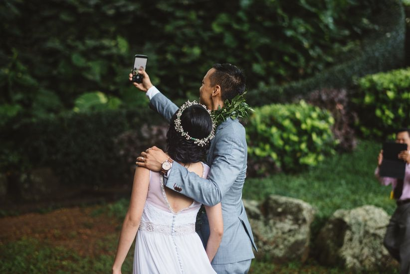 wedding couple taking selfie