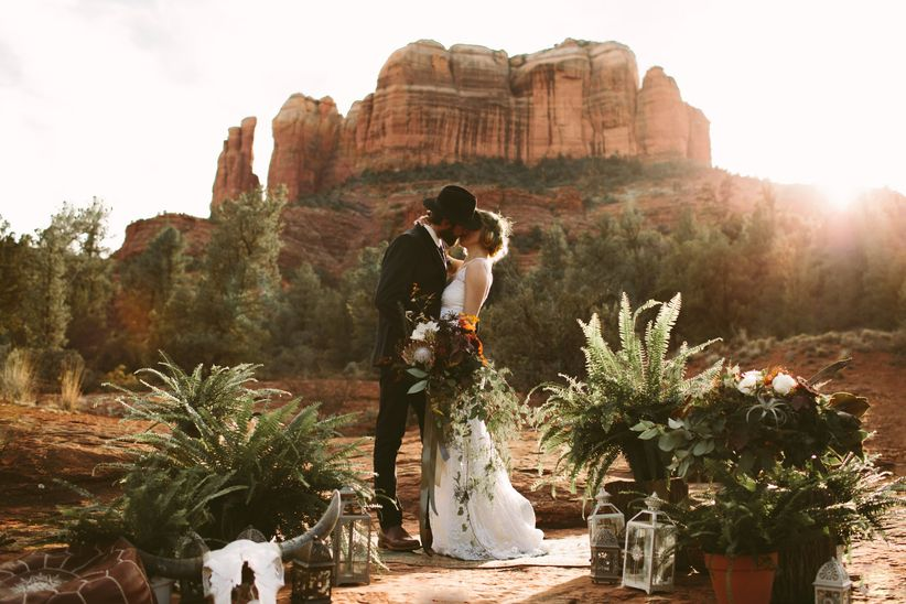 couple kissing in desert wedding
