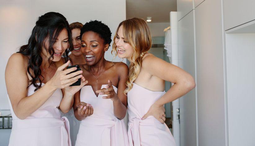 bridesmaids looking at phone