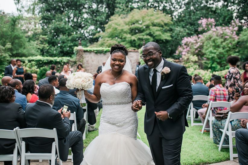 happy couple during wedding recessional