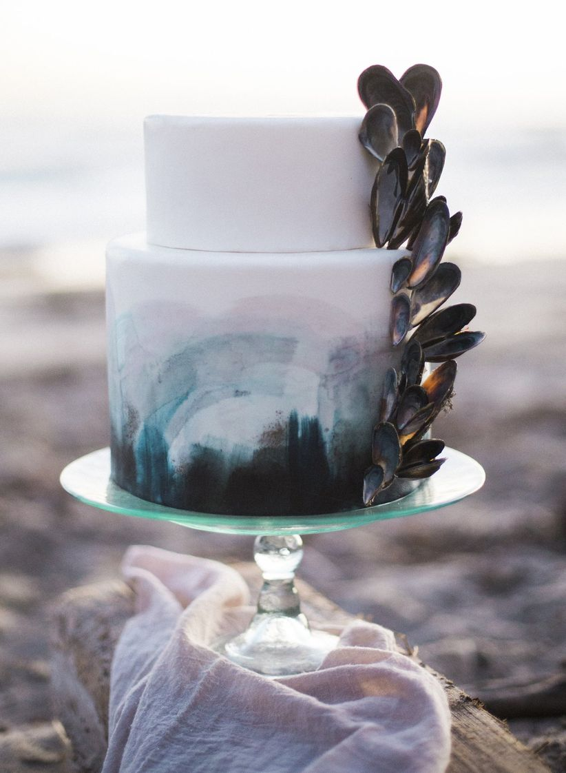 beach wedding cake decorated with blue ombre fondant and mussel shells