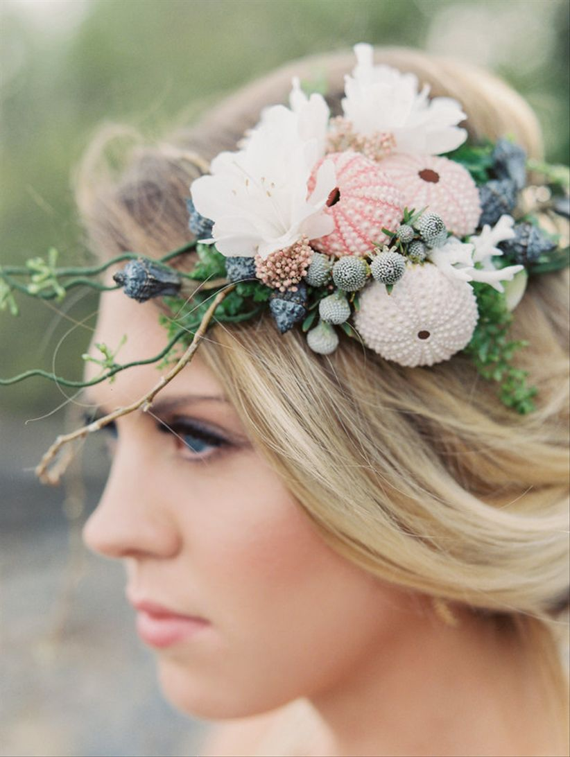 beach wedding hairpiece with seashells and fresh flowers