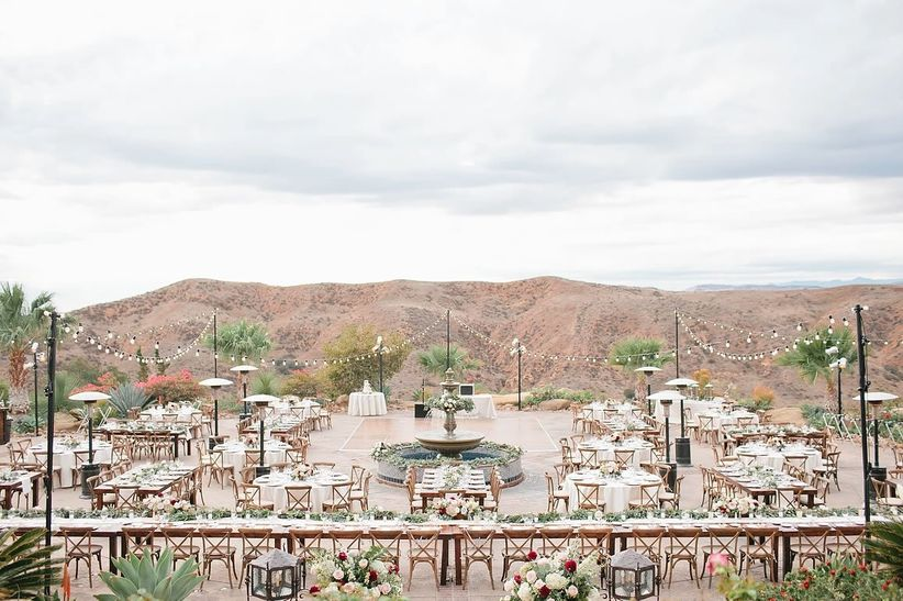 aerial view of outdoor wedding venue hummingbird's nest ranch long banquet tables set up with mountain view in the background