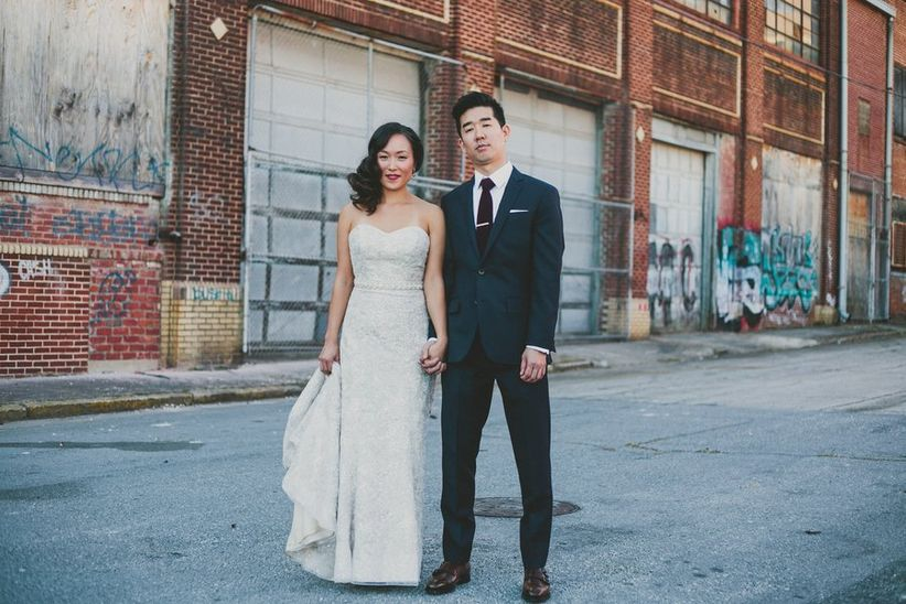 couple standing in front of factory space
