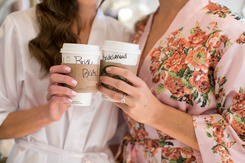 bride and bridesmaid holding starbucks cups