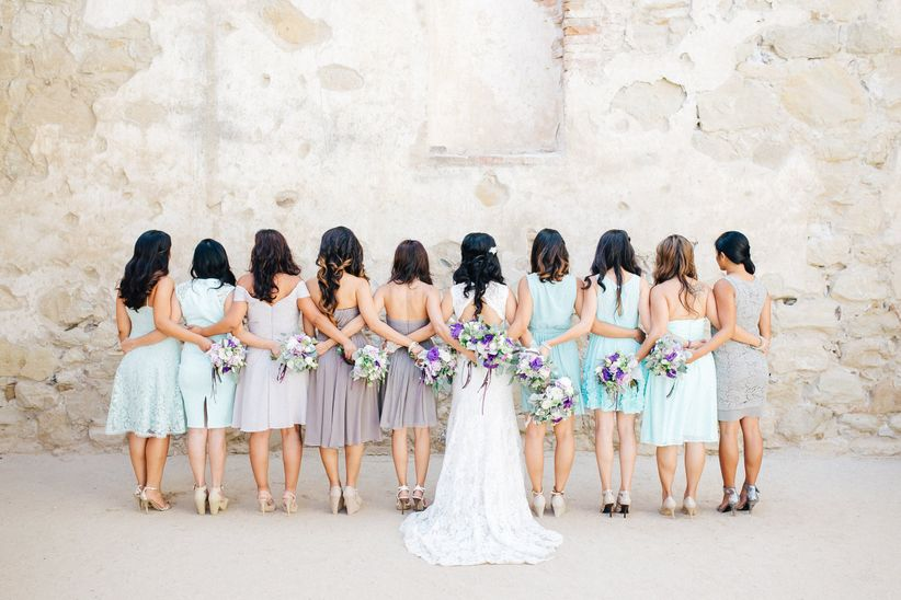 group of bridesmaids with arms around each other
