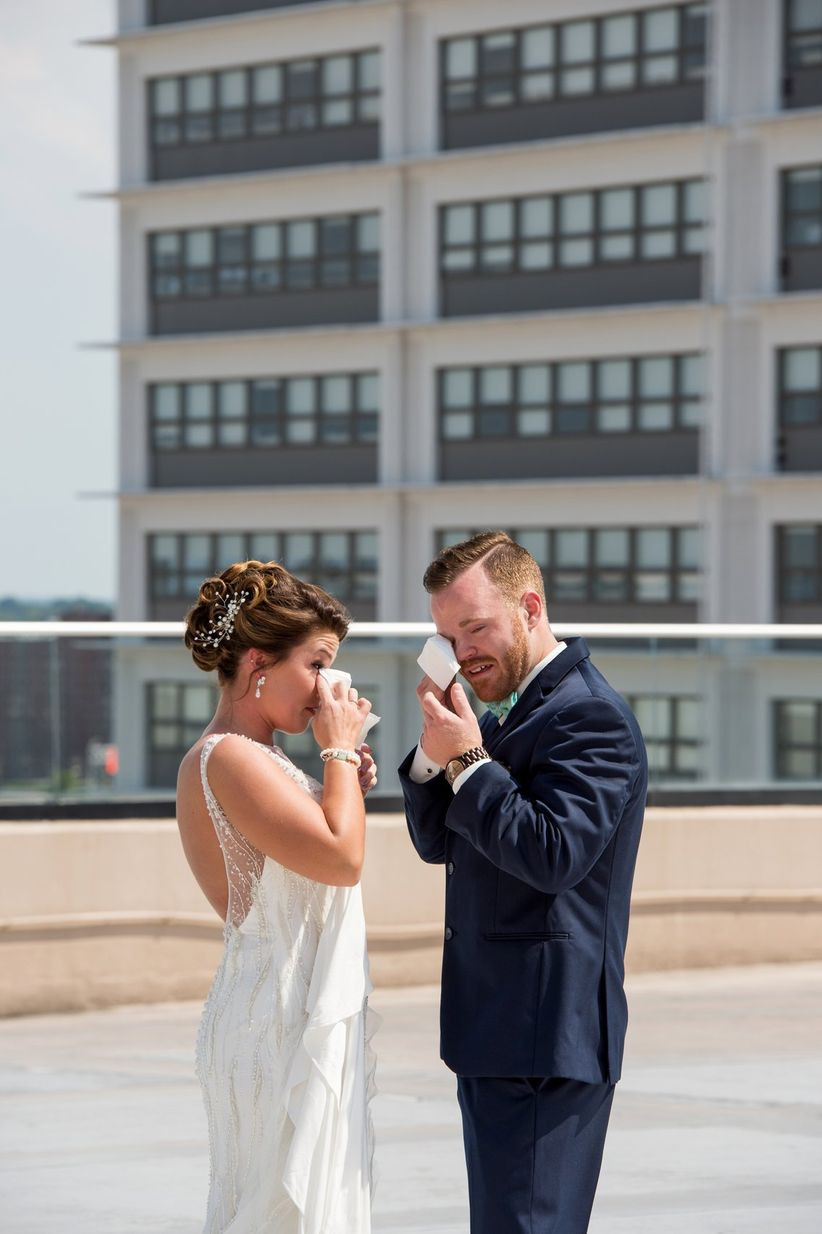 bride and groom crying during first look