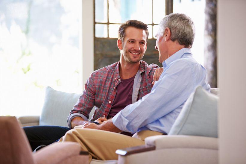 young man talking to older man