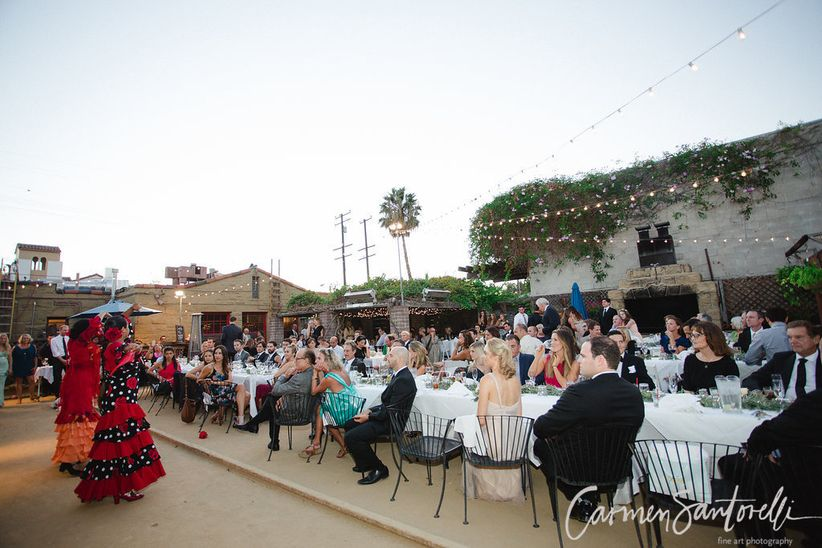 outdoor wedding reception with flamenco dancers performing for guests