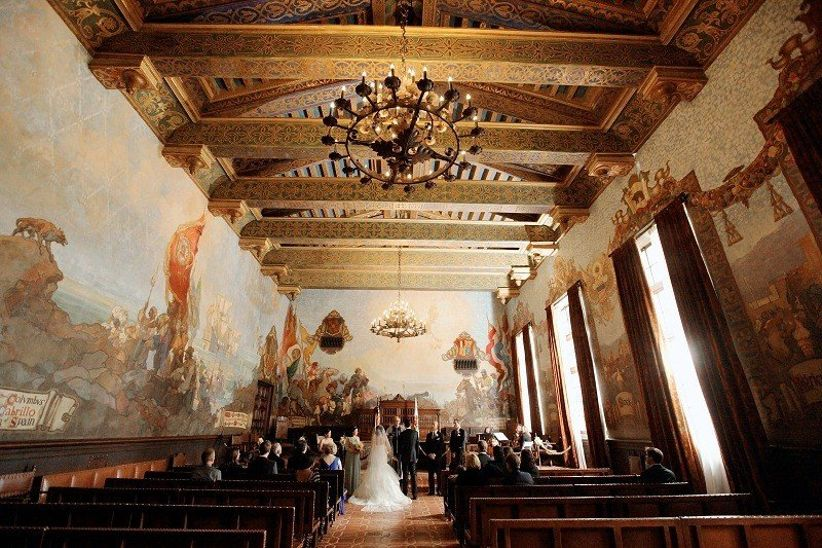 indoor wedding ceremony in Mural Room at Santa Barbara County Courthouse
