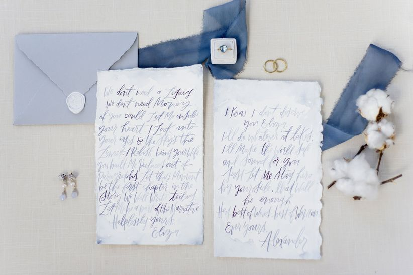 light blue and white watercolor wedding invitations with pale purple accents