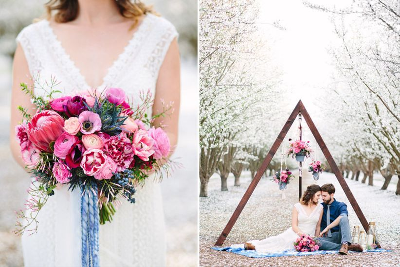 bride and groom pose at boho wedding with pink and blue decor