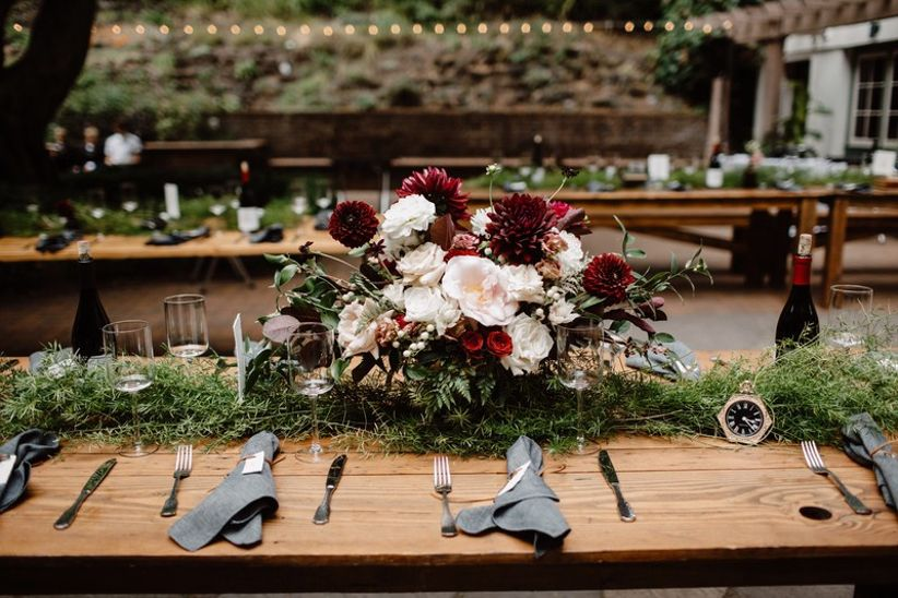 wedding reception tablescape with burgundy and pink centerpiece
