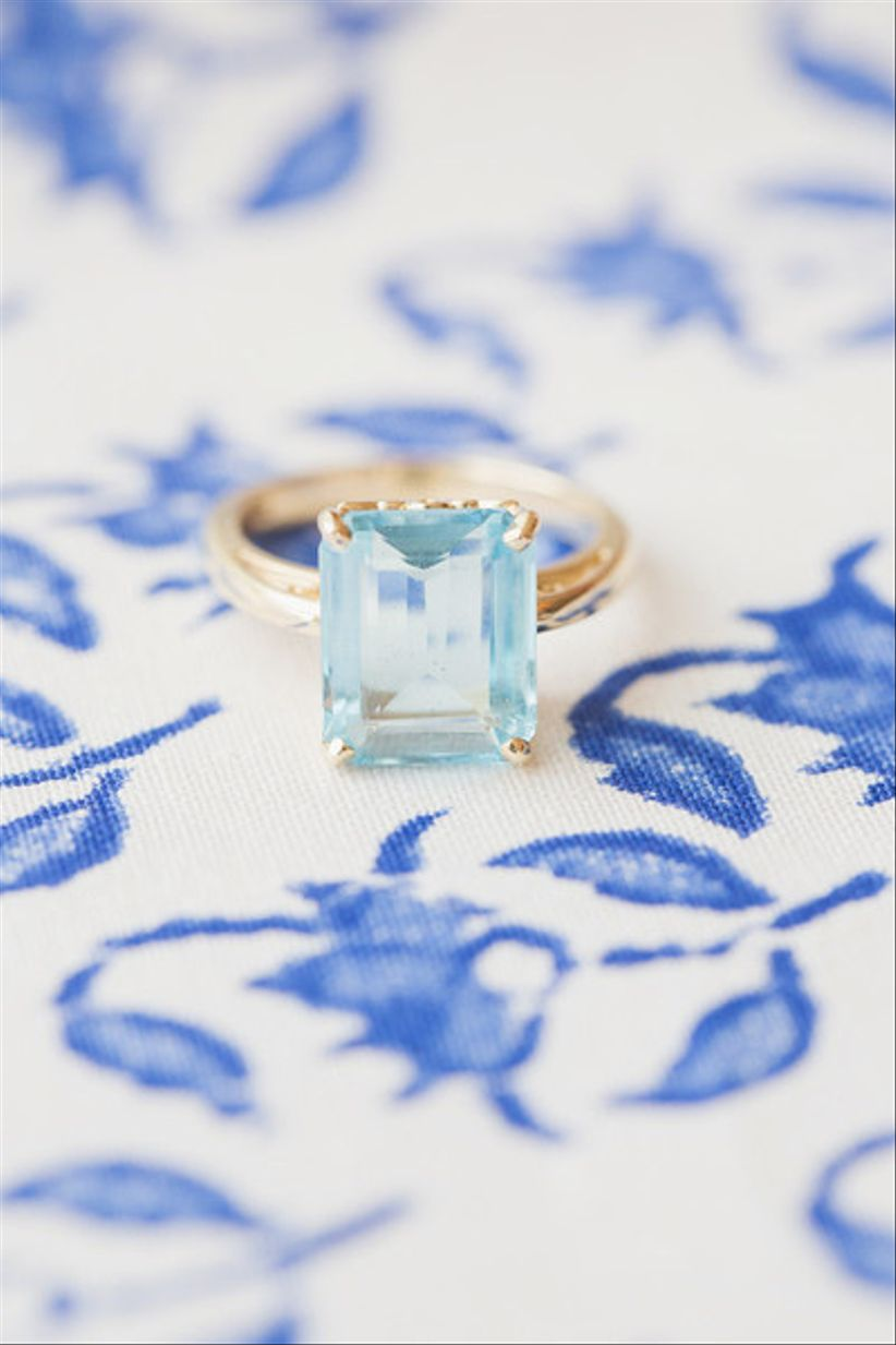 emerald-cut aquamarine engagement ring in gold prong setting