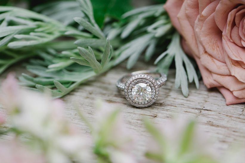 vintage-inspired engagement ring with round diamond and double halo setting