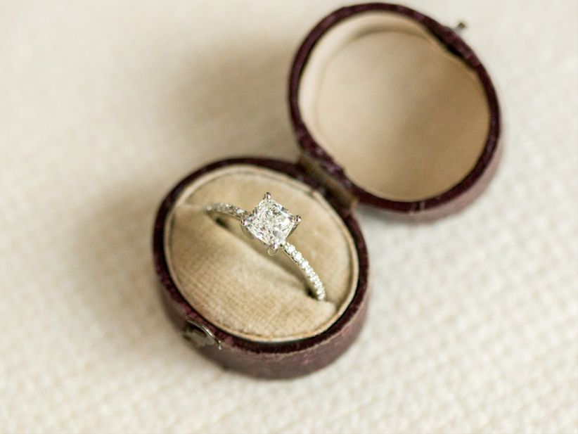 solitaire cushion-cut engagement ring with eternity band inside vintage ring box