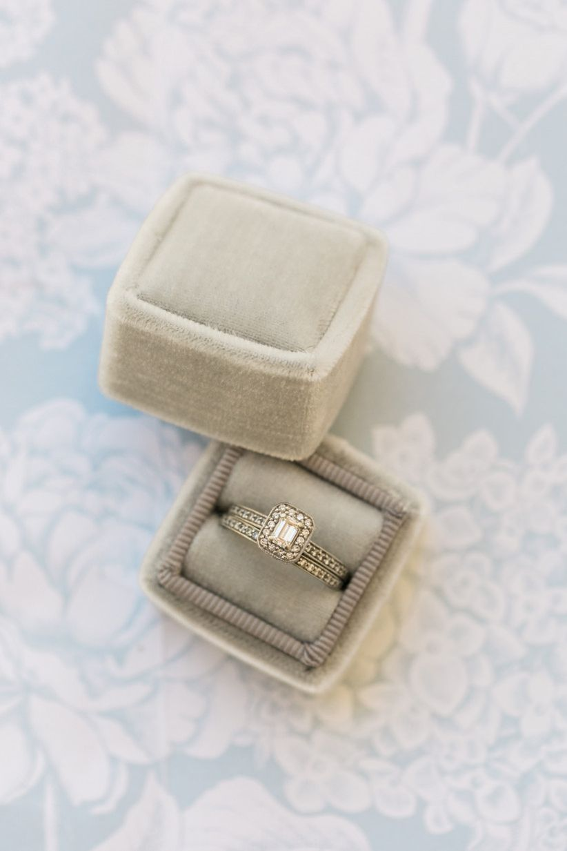 emerald-cut diamond engagement ring with gold channel setting and matching wedding band